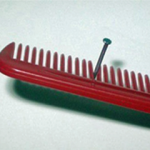Use a Comb to Hold A Nail Steady