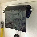 Mount your trash bags on a towel holder {organized CHAOS online}